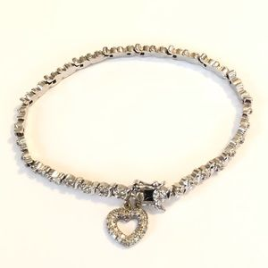 Jewelry - Silver diamond bracket with heart charm